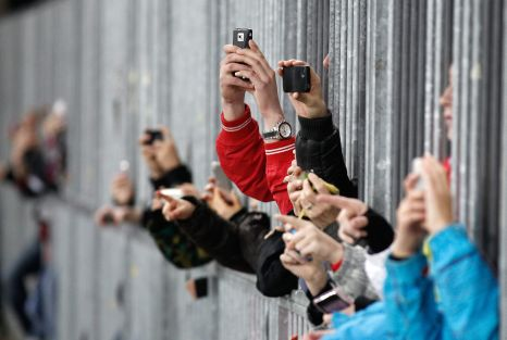 Soccer fans take pictures of Argentina's Captain Lionel Messi prior to a friendly soccer match between Switzerland and Argentina at the Stade de Suisse stadium in Bern, Switzerland, Wednesday, February 29, 2012. (KEYSTONE/Peter Klaunzer)